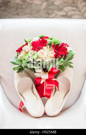 shoes of the bride and the bridal bouquet - Stock Photo