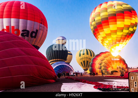 Hot air balloons preparing for flight on the West Bank of the Nile in Egypt. - Stock Photo