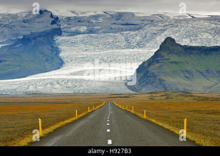 The Icelandic ring road and icy slopes of Iceland's highest mountain Hvannadalshnúkur. - Stock Photo