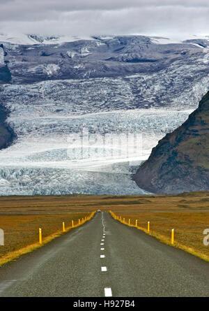 The Icelandic ring road and icy slopes of Iceland's highest mountain Hvannadalshnukur. - Stock Photo