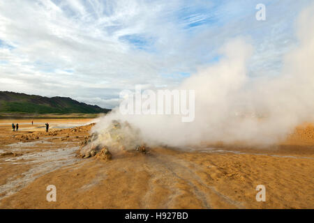 Steaming fumaroles volcanic vents at Hverir aka Hverarond east of Myvatn in central Iceland. - Stock Photo