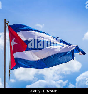 The national flag of Cuba captured flapping in the warm Caribbean breeze in Havana. - Stock Photo
