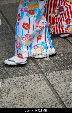 Geisha`s Traditional Sandals 'Geta' in Fushimi Inari shrine in Kyoto, Japan - Stock Photo