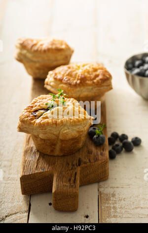 Puff pastries with cheese and berry filling - Stock Photo