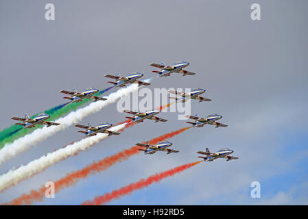 Italian Air Force Frecce Tricolori aerobatic display planes, Red Arrows, fly in cloudy weather - Stock Photo