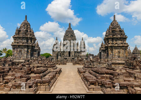 View of the Sewu temple complex under a blue sky with clouds. Java, Indonesia. - Stock Photo
