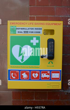 Automated external defibrillator (AED) on wall in Nantwich town centre, Nantwich, Ceshire, UK - Stock Photo