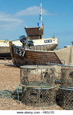 Small fishing boats pulled up onto the shingle beach, Hastings, East Sussex, England - Stock Photo