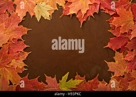 Fall leaves frame on brown background - Stock Photo