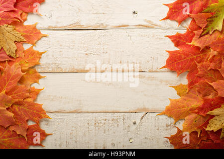Fall leaves frame on whooden background - Stock Photo