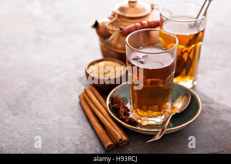 Hot sweet tea with cinnamon - Stock Photo