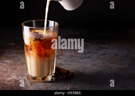 Hot masala tea with milk - Stock Photo