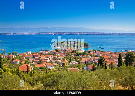 Island of Ugljan picturesque coast with Zadar and Velebit mountain, Dalmatia, Croatia - Stock Photo