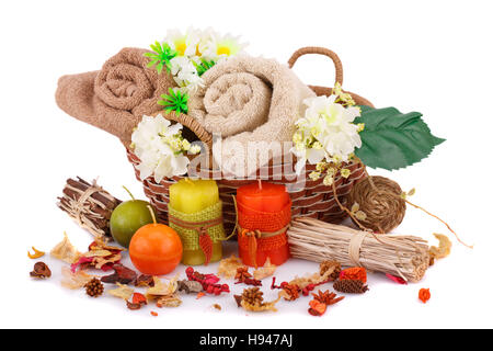 Spa set with towels, candles and flowers isolated on white background. - Stock Photo