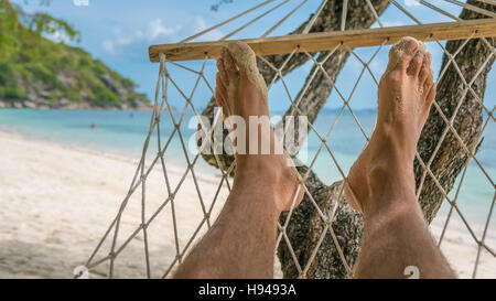 Relax on the Beach in Hammock, Haad Rin , Koh Pangang - Stock Photo