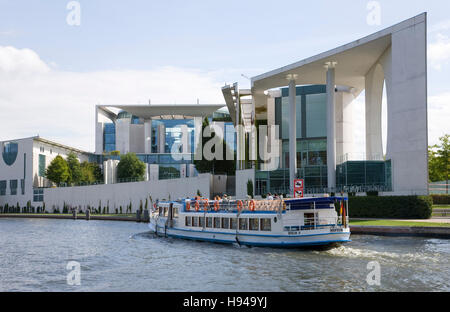Excursion boat on the Spree river in front of Bundeskanzleramt, Federal Chancellery, government buildings, shipping, - Stock Photo