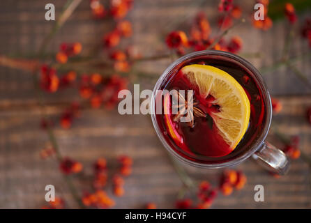 Warming up by degustating mulled wine - Stock Photo