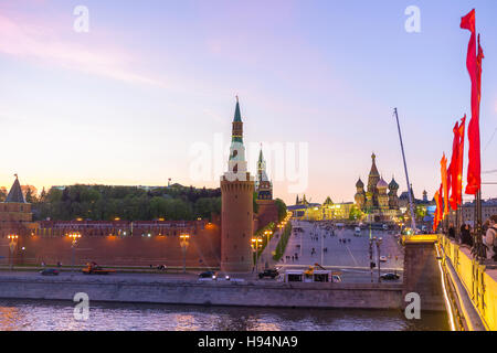 The view on brightly illuminated Red Square from the Bolshoy Moskvoretsky bridge - Stock Photo