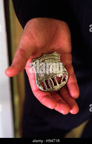 U.S. President George W. Bush holds the badge of a police officer killed in the September 11 terrorist attacks at - Stock Photo