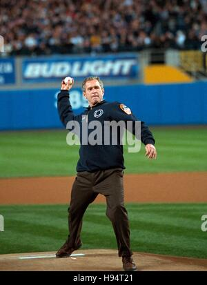 U.S. President George W. Bush throws the ceremonial first pitch before Game Three of the World Series between the - Stock Photo