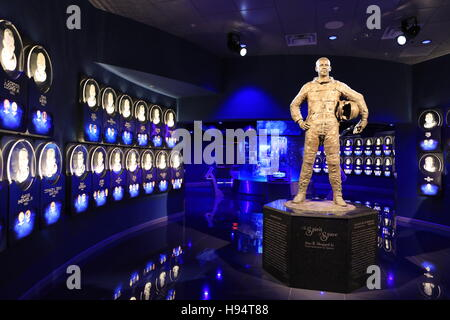 A statue of NASA astronaut Alan Shepard at the Heroes and Legends attraction stands inside the doors to the U.S. - Stock Photo