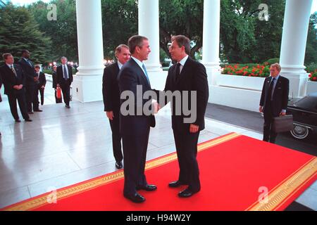 U.S. President George W. Bush greets British Prime Minister Tony Blair at the White House North Portico entrance - Stock Photo