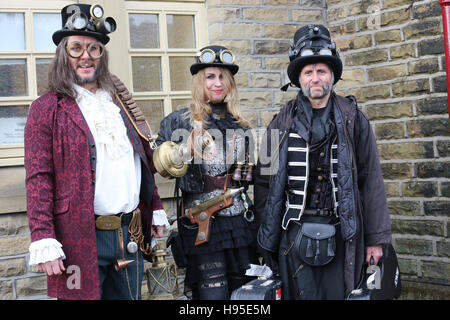 Haworth, UK. 19th Nov, 2016. Three steampunks stood next to a wall in Haworth, 19th November 2016. Credit:  Barbara - Stock Photo