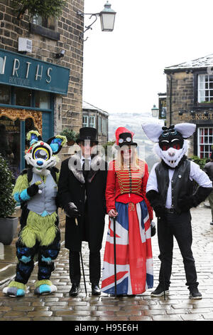 Haworth, UK. 19th Nov, 2016. A row of four people dressed in costumes for the Steampunk weekend in Haworth, 19th - Stock Photo