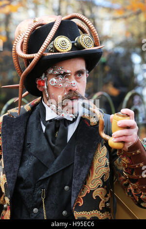 Haworth, UK. 19th Nov, 2016. A man wearing Steampunk designed clothing with a large pipe, Haworth, 19th November - Stock Photo