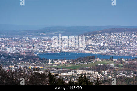 The city of Zurich, Switzerland, with lake Zurich in the foreground. Seen from Albispass, looking into northeastern - Stock Photo