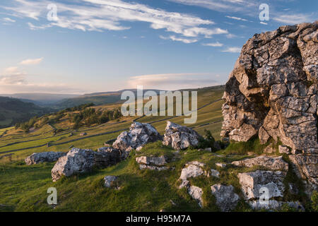 Summer evening view of beautiful Yorkshire Dales countryside seen from Conistone Pie, a limestone outcrop - North - Stock Photo