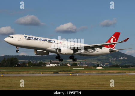Zurich, Switzerland - July 29, 2016: Turkish Airlines, Airbus A330-300 is landing at Zurich Airport - Stock Photo