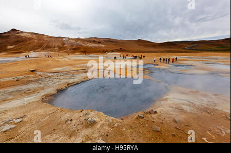 A view of the Hverir Geothermal Field by Mt. Namafjall next to Lake Myvatn, Iceland. - Stock Photo