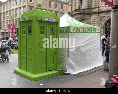 ... green vegan restaurant pop up police box dr who tardis site for The Ivy Glasgow World & Man holding a fried egg and bacon sandwich Stock Photo Royalty ...