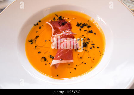 Andalusian gazpacho cream of tomato and ham - Stock Photo