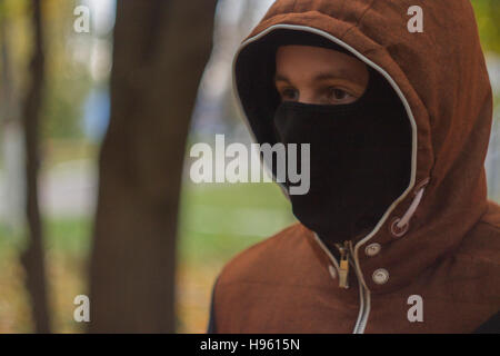 young man in  mask - Stock Photo