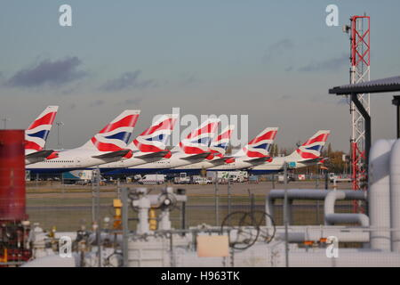 British Airways planes lined up at the terminal 5 at London Heathrow airport, UK - Stock Photo