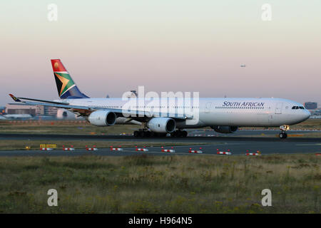 Frankfurt, Germany - July 18, 2016: South African Airways, Airbus A340-600 at Frankfurt Airport after sunset - Stock Photo