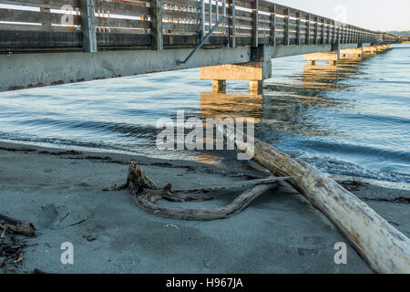 A view of the fishing pier in Dash Point, Washington at high tide. - Stock Photo