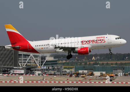 Stuttgart, Germany – May 07, 2016: Iberia Express, Airbus A320 is landing at Stuttgart Airport - Stock Photo