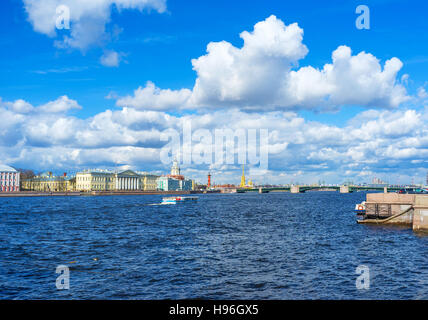 The view from Admiralty embankment on clouds over Bolshaya Neva river, the landmarks of Vasilyevsky Island, Palace - Stock Photo