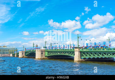 The view from Admiralty embankment of Neva river on the Palace Bridge, one of the most famous sites in city - Stock Photo