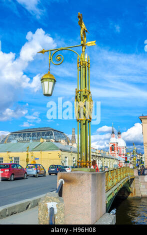 The old scenic streetlight on Panteleimonovsky bridge with the red bell tower of St Panteleimon Church in front - Stock Photo