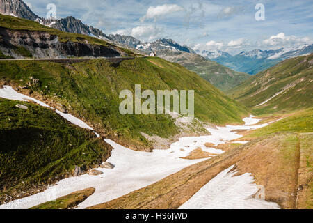 Valley near top of Furka pass, road on the left, Switzerland - Stock Photo