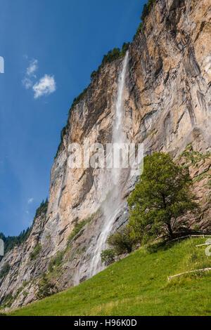 The Staubbach Falls (Staubbachfall) more than 300 meters high in Alps near Lauterbrunnen, Switzerland - Stock Photo