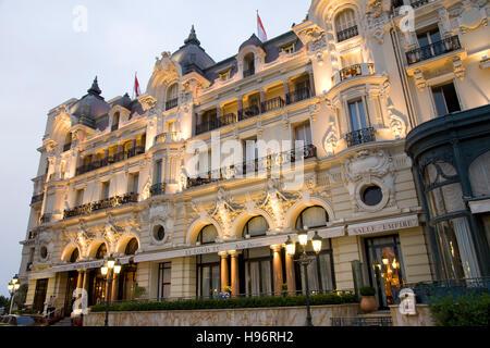 Hotel de Paris at dusk, luxury hotel, Monte Carlo, Monaco, Cote d'Azur, France - Stock Photo