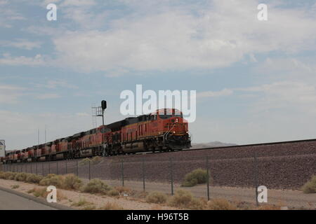 Red diesel train transporting industrial goods. - Stock Photo
