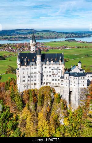 Famous Neuschwanstein Castle in autumn. Germany, Bavaria. Beautiful german landscape - Stock Photo