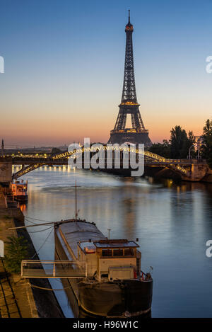 Sunrise on the Eiffel Tower, the Seine River and Pont Rouelle bridge. Paris, France - Stock Photo