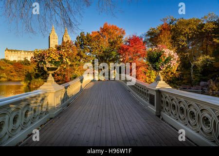Fall in Central Park at The Lake with the Bow Bridge. Sunrise view with colorful autumn foliage. Upper West Side, - Stock Photo